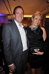 NADJA SWAROVSKI and RUPERT ADAMS at a party to launch the book 'Italian Touch' - A Celebration of Italian Lifestyle held at TOD's, 2-5 Old Bond Street, London on 4th November 2009.