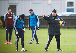 © London News Pictures. 28/01/2014. London, UK. Manager SAM ALLARDYCE (right) during West Ham United training at their training ground in Chadwell Heath, East London ahead of their premiership game away to Chelsea on tomorrow night (29/01/2014). Photo credit: Ben Cawthra/LNP