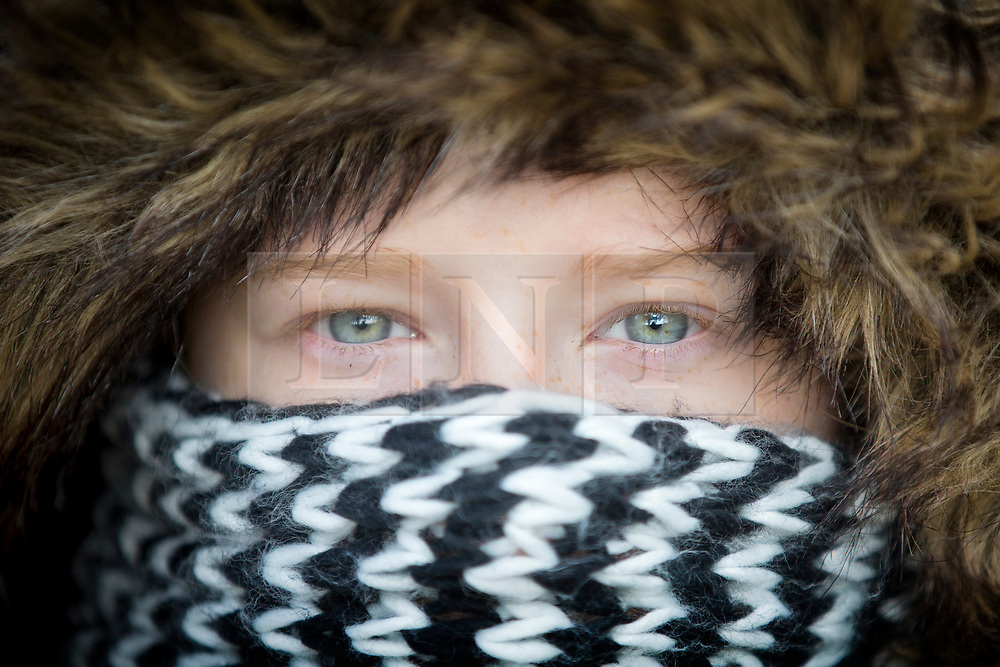 """© Licensed to London News Pictures. 25/02/2018. Leeds UK. 12 year old Cerys wraps up warm for a walk through Temple Newsam park in Leeds this morning as the temperature begins to drop across the UK ahead of the expected arrival of a cold blast known as """"the beast from the east"""" from Russia. Photo credit: Andrew McCaren/LNP"""