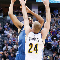 15 February 2017: Minnesota Timberwolves center Karl-Anthony Towns (32) goes for the baby hook over Denver Nuggets center Mason Plumlee (24) during the Minnesota Timberwolves 112-99 victory over the Denver Nuggets, at the Pepsi Center, Denver, Colorado, USA.