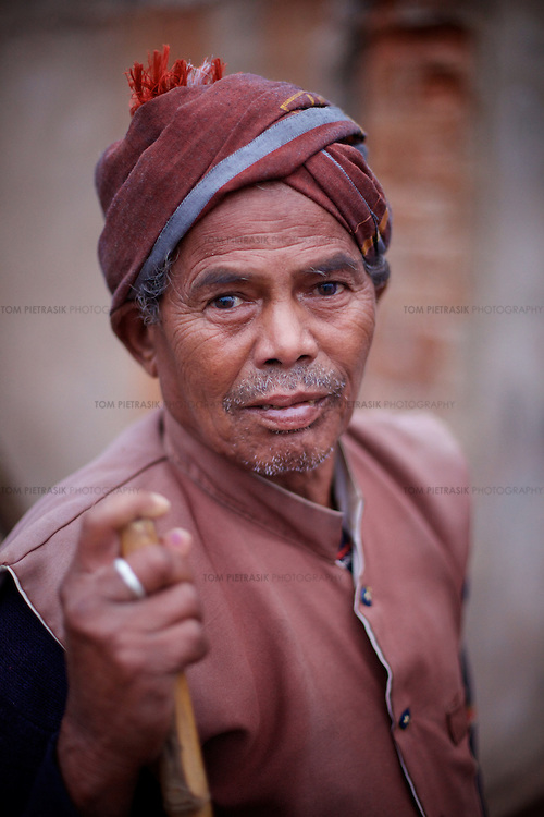 """Dhurve, 70, from the adivasi (tribal) Gond community lives in Singhari village. Dhurve was relocated from his home to make way for the 668 hectare bauxite Bodhi Daldali mine, run by Balco & Vedanta (Vedanta is a UK headquartered company). He feels that Balco has turned their lives topsy turvey. """"The sweetness you had in the water and the grains in the forest cannot be replicated in the plains.""""<br /> <br /> Photo: Tom Pietrasik<br /> Kawardha District, Chhattisgarh. India<br /> February 20th 2011"""