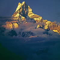 """NEPAL, HIMALAYA. Sunset on 6997-meter Machhapuchhare Peak (""""The Fish Tail"""") in Annapurna massif above Pokhara."""