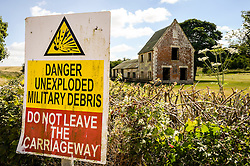 A military sign in front of Seagram's Farm in Imber village on Salisbury Plain, Wiltshire, where residents were evicted in 1943 to provide an exercise area for US troops preparing to invade Europe. Roads through the MoD controlled village are now open and will close again on Monday August 22.