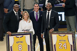 December 18, 2017 - Los Angeles, California, U.S - (L-R) Magic Johnson, Jeanie Buss, Rob Pelinka and Kobe Bryant pose during Kobe Bryant's jersey retirement ceremony at halftime of a basketball game between the Los Angeles Lakers and the Golden State Warriors at Staples Center on Monday December 18, 2017 in Los Angeles, California. (Credit Image: © Prensa Internacional via ZUMA Wire)
