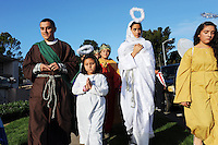 The Posadas Navideñas procession wends its way through the Acosta Plaza apartment complex on Thursday in Salinas. The event recreates the search of Mary and Joseph for shelter during their journey from Nazareth to Bethlehem.
