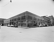 """Ackroyd 00072-28. """"Montgomery Ward Warehouse. May 17, 1947."""" exterior view shows the southwest corner of NW 5th & Hoyt."""