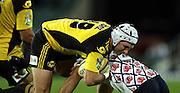 Scott Waldrom tackled<br />Super 14 rugby union match, Waratahs vs Hurricanes, Sydney, Australia. <br />Saturday 14 May 2010. Photo: Paul Seiser/PHOTOSPORT