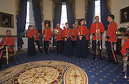 MUSICIANS IN THE BLUE ROOM AWAIT THEIR SIGNAL TO PERFORM FOR THE PRESIDENT AND HIS GUESTS.