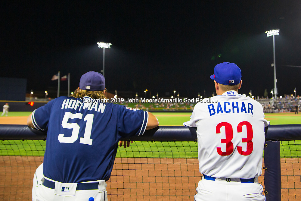Trevor Hoffman and Amarillo Sod Poodles pitcher Lake Bachar (33) watch the game against the Frisco RoughRiders on Thursday, Aug. 1, 2019, at HODGETOWN in Amarillo, Texas. [Photo by John Moore/Amarillo Sod Poodles]