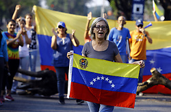 April 30, 2019 - Valencia, Carabobo, Venezuela - Oldr woman walks with flag. The venezuelans star a new protest against Maduro. The interim president Juan Guaido call to take the street in all Venezuela. This photos ar from the Valencia city, Carabobo state. Photo: Juan Carlos Hernandez (Credit Image: © Juan Carlos Hernandez/ZUMA Wire)