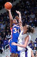 Kansas forward Lindsay Ballweg (34) puts up a shot over Kansas State forward Ashley Sweat (4), during the first half at Bramlage Coliseum in Manhattan, Kansas, January 24, 2007.  K-State leads the Jayhawks at halftime 36-29.