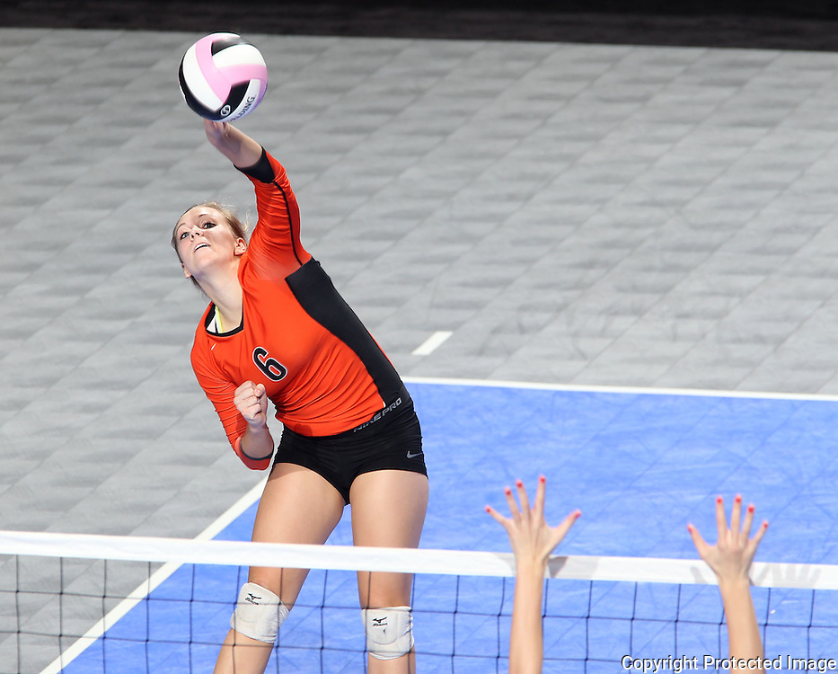 West Delaware's Mackenzie Harbaugh (6) goes for a kill during the second game of a 3A semifinal in the state volleyball tournament at the U.S. Cellular Center at 370 1st Ave E on Friday afternoon, November 12, 2010. (Stephen Mally/Freelance)