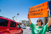 """06 JUNE 2012 - PHOENIX, AZ:   A supporter of US Army PFC Bradley Manning pickets a street corner in Phoenix Wednesday. About 10 people gathered on a street corner in central Phoenix Wednesday to support Manning, who been criminally charged for passing secrets in the """"wikileaks"""" case and is awaiting trial in a US Army jail.       PHOTO BY JACK KURTZ"""