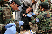 """ANA soldiers from 3rd Brigade, 201st Corps, provide free medical care to villagers during an operation in Tagab Valley.....Colonel Haynes said the battle plan, """"The creeping barrage of goodness,"""" to win the hearts and minds of the Tagab Valley includes: a paved road, wells, radio stations, solar power, humanitarian aid, and medical outreach.  Agricultural development teaching how to package goods, and pruning techniques to increase crop yields.  Saffron cultivation started too, as a replacement to poppy.  More projects like schools and police checkpoints will follow as resources allow..."""