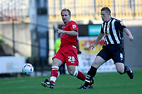 Photo: Pete Lorence.<br />Notts County v Swindon Town. Coca Cola League 2. 23/09/2006.<br />Royce Brownlie of Swindon sends the ball up the field and avoids Dan Martin.