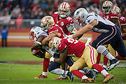 The San Francisco 49ers defense gangs up on New England Patriots running back Dion Lewis (33) to take him down during a carry at Levi's Stadium in Santa Clara, Calif., on November 20, 2016. (Stan Olszewski/Special to S.F. Examiner)
