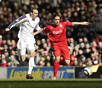 Photo: Aidan Ellis.<br /> Liverpool v Bolton Wanderers. The Barclays Premiership. 09/04/2006.<br /> Liverpool's Harry Kewell holds off Bolton's Nicky hunt