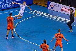 11-04-2019 NED: Netherlands - Slovenia, Almere<br /> Third match 2020 men European Championship Qualifiers in Topsportcentrum in Almere. Slovenia win 26-27 / Tilen Kodrin #20 of Slovenia