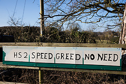 Great Missenden, UK. 28th February, 2021. An anti-HS2 sign is pictured outside a farm in the Chilterns. Local residents and environmental activists continue to show their opposition to the destruction of ancient woodland, trees and hedgerows in the the Chilterns, which is an Area of Outstanding Natural Beauty.