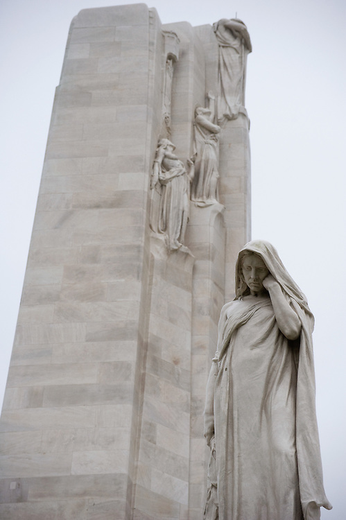 The Weeping Woman or Mother Canada mourning her dead in the Canadian National Vimy Memorial dedicated to the memory of Canadian Expeditionary Force members killed in World War one. The monument is situated at a 100 hectare preserved battlefield with wartime tunnels, trenches, craters and unexploded munitions. The memorial designed by Walter Seymour Allward opened in 1936.