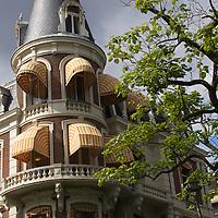 Europe, Netherlands, Amsterdam. Amsterdam Building on a corner.