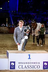 MCMAHON Eoin (IRL)<br /> Siegerehrung<br /> Grand Prix von Volkswagen<br /> Int. jumping competition over two rounds (1.55 m) - CSI3*<br /> Comp. counts for the LONGINES Rankings<br /> Braunschweig - Classico 2020<br /> 08. März 2020<br /> © www.sportfotos-lafrentz.de/Stefan Lafrentz
