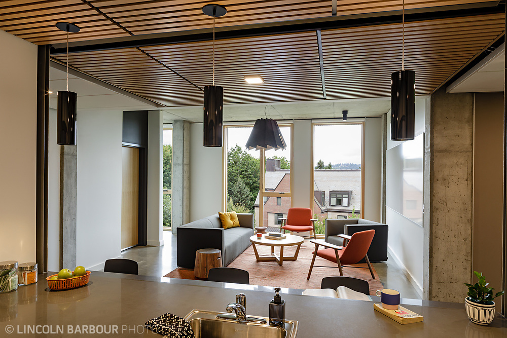 A view of a sitting area/common space from the kitchen inside of Trillium Residence Hall at Reed College in Portland, Oregon.