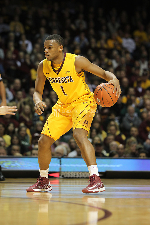 Dec 31, 2012; Minneapolis, MN, USA; Minnesota Golden Gophers guard Andre Hollins (1) against the Michigan State Spartans at Williams Arena. Minnesota defeated Michigan State 76-63. Mandatory Credit: Brace Hemmelgarn