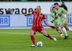 WOLFSBURG, Feb. 18, 2018  Bayern Munich's Arjen Robben (Front) takes a penalty shot during a German Bundesliga match between VfL Wolfsburg and Bayern Munich, in Wolfsburg, Germany, on Feb. 17, 2018. Bayern Munich won 2-1. (Credit Image: © Shan Yuqi/Xinhua via ZUMA Wire)