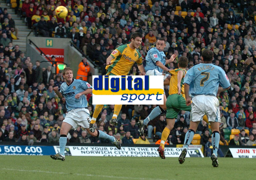 Photo: Ashley Pickering.<br />Norwich City v Hull FC. Coca Cola Championship. 25/11/2006.<br />Hull's Damien Delaney (centre blue) heads just wide of the post in the first half