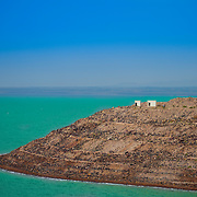 The Dead Sea – bordering Israel, the West Bank and Jordan – is a salt lake whose banks are more than 400m below sea level, the lowest point on dry land. Its famously hypersaline water makes floating easy, and its mineral-rich black mud is used for therapeutic and cosmetic treatments at area resorts. The surrounding desert offers many oases and historic sites.
