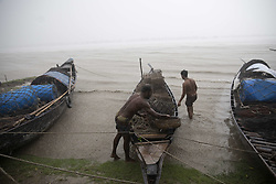 May 3, 2019 - Khulna, India - Fishing boats are seen at the Batiaghat by pass. Fishermen ashore their boats to the river bank of Rupsha river as they withdraw from the Sea fishing after cyclone storm 'Fani' alert to landfall on Bay of Bengal on May 04, 2019. (Credit Image: © Ahmed Salahuddin/NurPhoto via ZUMA Press)