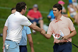 June 22, 2018 - Cromwell, Connecticut, United States - Beau Hossler (R) shakes hands with Keegan Bradley after the second round of the Travelers Championship at TPC River Highlands. (Credit Image: © Debby Wong via ZUMA Wire)