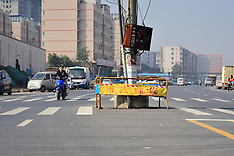 China: Telegraph Pole Standing at Crossroad in C China, 3 Nov. 2016