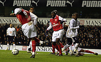 Photo: Paul Thomas.<br /> Tottenham Hotspur v Arsenal. Calring Cup, Semi Final 1st Leg. 24/01/2007.<br /> <br /> Kolo Toure (C) of Arsenal and Spur's Pascal Chimbonda (R) watch Julio Baptista (L) miss an open goal for Arseanl just before half time.