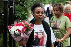 London, UK. 14th June, 2018. The sister of Brikti Haftom, who died in the Grenfell Tower fire, arrives for the Grenfell Memorial Service at St Helen's Church.