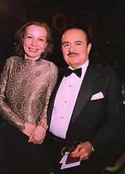 MRS ELIZABETH TSAKIROGLOU and MR ADNAN KHASHOGGI the multi millionaire middle eastern businessman, at a ball in London on 19th November 1997.MDL 8
