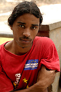 The portrait of a young shepperd  in the abandoned village of Vinagre in Brava's east coast. Vinagre is so called because of the acid fountain water that reminds vinegar. The young man is wearing a political t-shirt from one of the candidates for President.