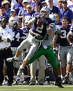 Kansas State safety Marcus Watts (2) intercepts the pass in front of Marshall wide receiver Marcus Fitzgerald at Bill Snyder Family Stadium in Manhattan, Kansas, September 16, 2006.  The Wildcats beat the Thundering Herd 23-7.