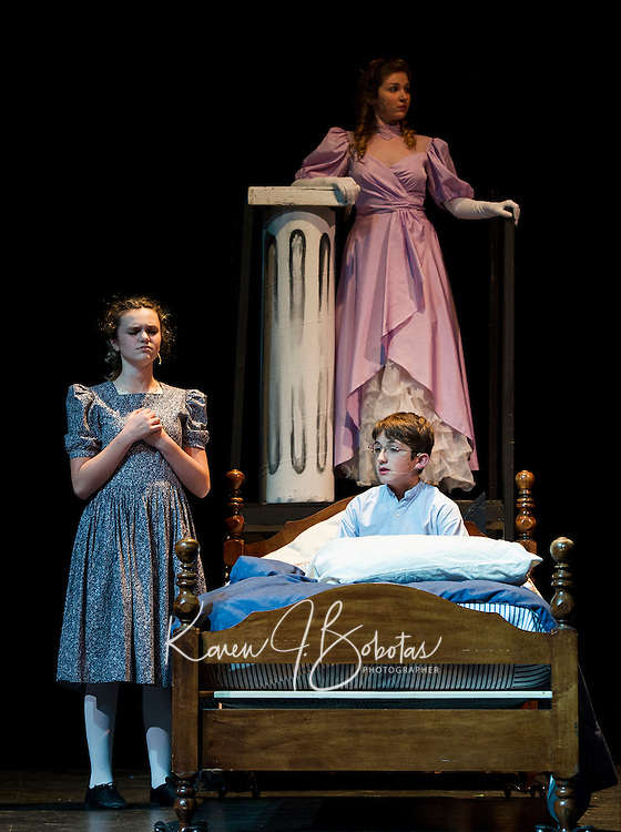 """Cyndal VanSteensburg as Mary by the byside of Chandler Green as Colin with Kayla Zarella as Lily during dress rehearsal for """"The Secret Garden"""" at Gilford High School on Wednesday evening.  (Karen Bobotas/for the Laconia Daily Sun)"""