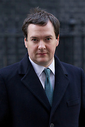 © Licensed to London News Pictures. 26/11/2013. London, UK. The Chancellor of the Exchequer, George Osborne, leaves Number 10 Downing Street after a meeting of British Prime Minister David Cameron's Cabinet on Downing Street in London today (26/11/2013). Photo credit: Matt Cetti-Roberts/LNP