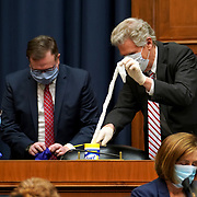 Reps. Eliot Engel (D-N.Y.) and Frank Pallone (D-N.J.) prepare to clean their seats as they prepare to leave a House Energy and Commerce Subcommittee on Health hearing to discuss protecting scientific integrity in response to the coronavirus outbreak on Thursday, May 14, 2020.