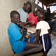 Small boys enthusiastically play the drums at a prayer meeting for Sudanese Christians at a UNHCR transit camp at Dadaab, Kenya. This community was recently relocated here, following the burning of their church by Somali Muslims.