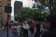 Media reporting from Bramley Road near the burnt shell of Grenfell Tower on 16th June 2017 in West London, United Kingdom. The Grenfell Tower fire occurred on 14th June 2017 at the 24-storey block of public housing flats in North Kensington, West London. It caused at least 80 deaths and over 70 injuries, yet the actual numbers have yet to be confirmed
