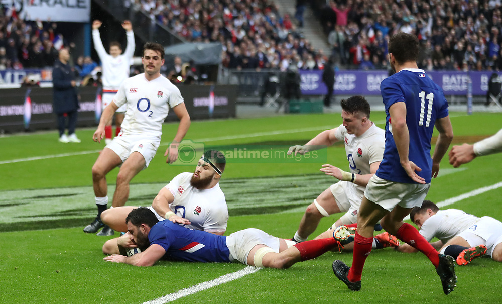 England's Luke Cowan-Dickie goes in late on France's Charles Ollivon as he scores hiss ides third try of the game during the Guinness Six Nations match at the Stade de France, Paris.