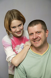 Portrait of father and daughter together,