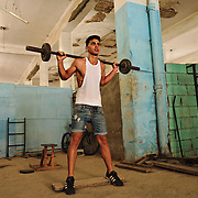 Working out in a warehouse converted into a gym in Centro Habana.