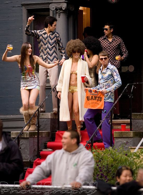 Unidentified spectators on Fell Street appear to have been staging a '70s dance party during the 100th running of the Bay to Breakers 12K through San Francisco, Sunday, May 15, 2011. (Photo by D. Ross Cameron)