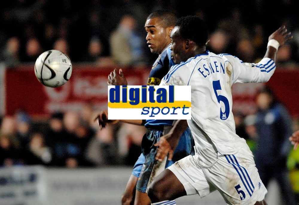 Photo: Richard Lane.<br />Wycombe Wanderers v Chelsea. Carling Cup, Semi Final 1st Leg. 10/01/2007. <br />Wycombe's Jermaine Easter beats Michael Essien to set up his goal.
