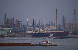 Tankers passing by a refinery